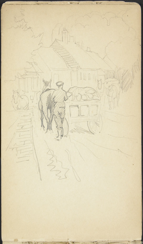 Soldier and military wagon moving through a Belgian town