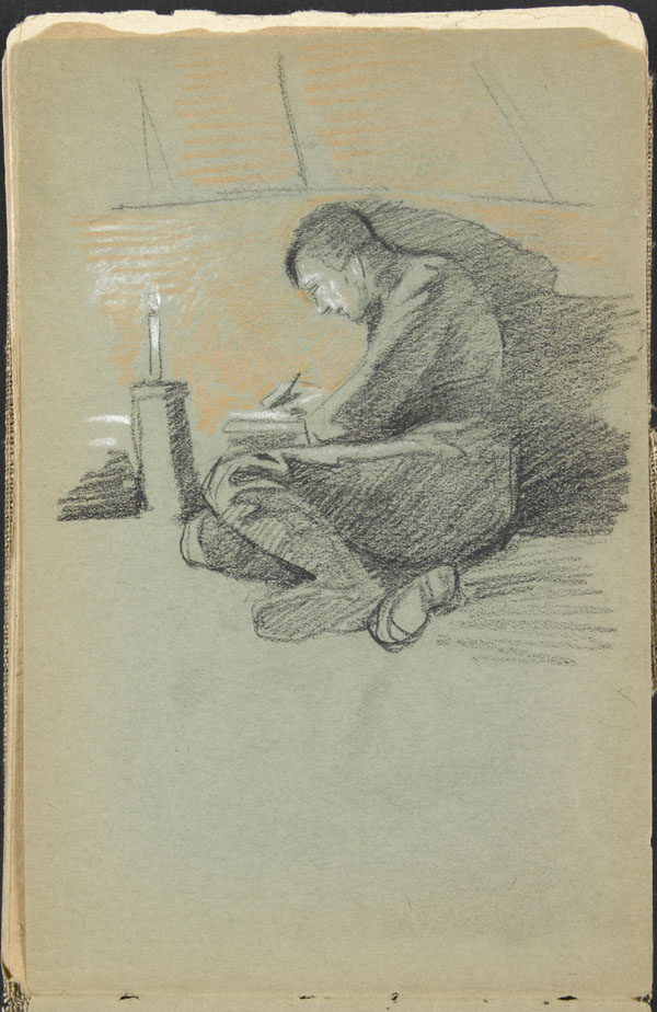 Soldier writing by candlelight