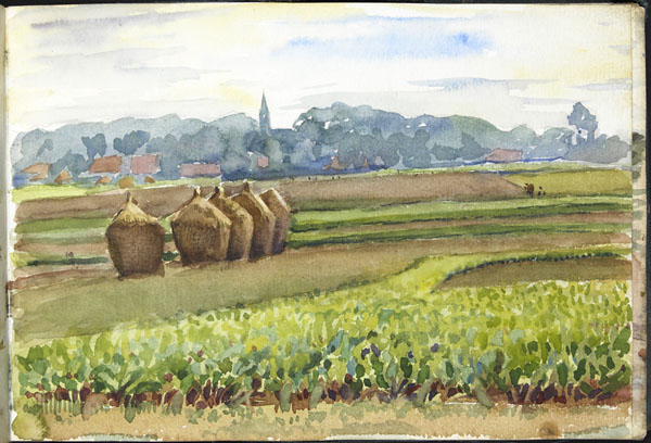 Distant view of a town and its church belltower, seen from surrounding fields, Pas-de-Calais