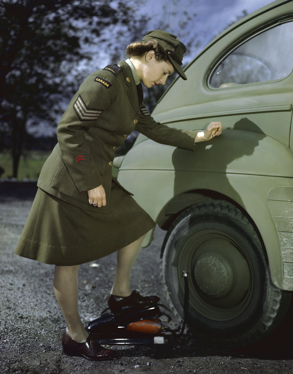 CWAC Sgt. Shirley McNeill and Foot Pump (Winter Dress) . (item 1)