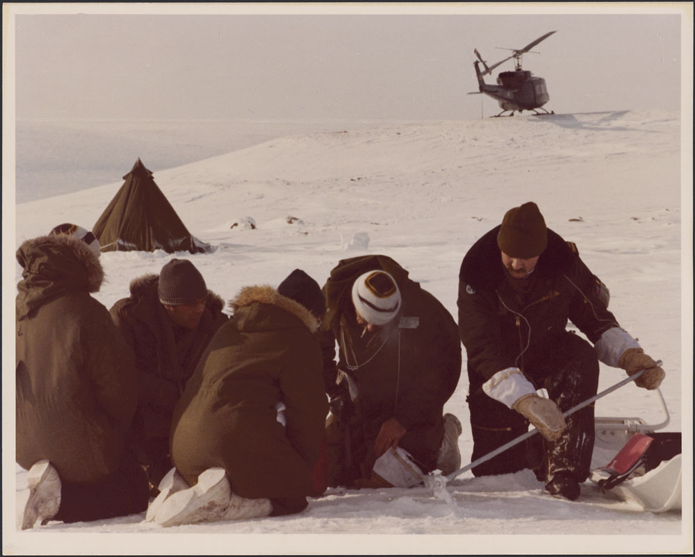 Photo of a team searching for debris from the Soviet satellite COSMOS 954 in Cape Dorset, Northwest Territories (now Nunavut).