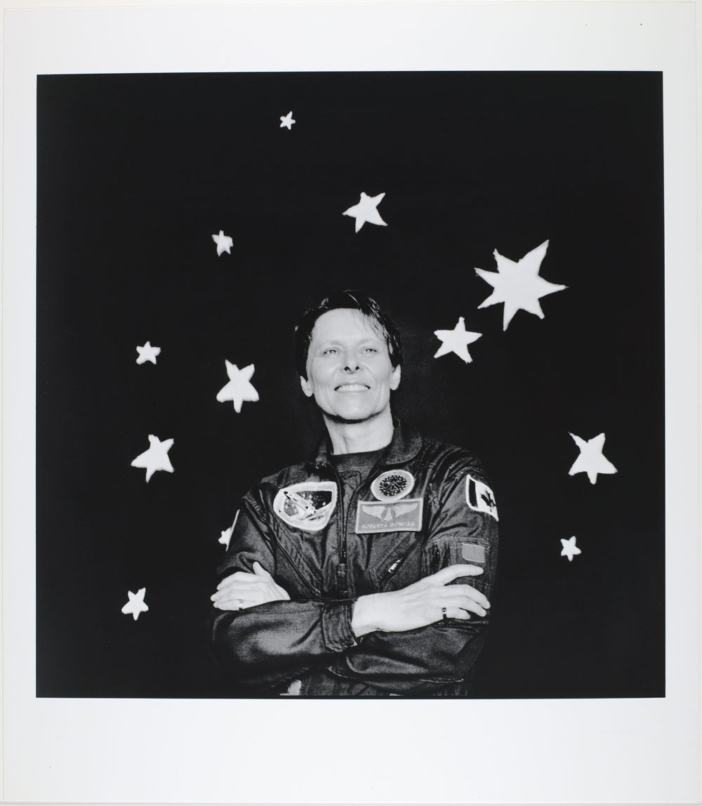 Photo of Roberta Bondar with stars in the background, 1999.