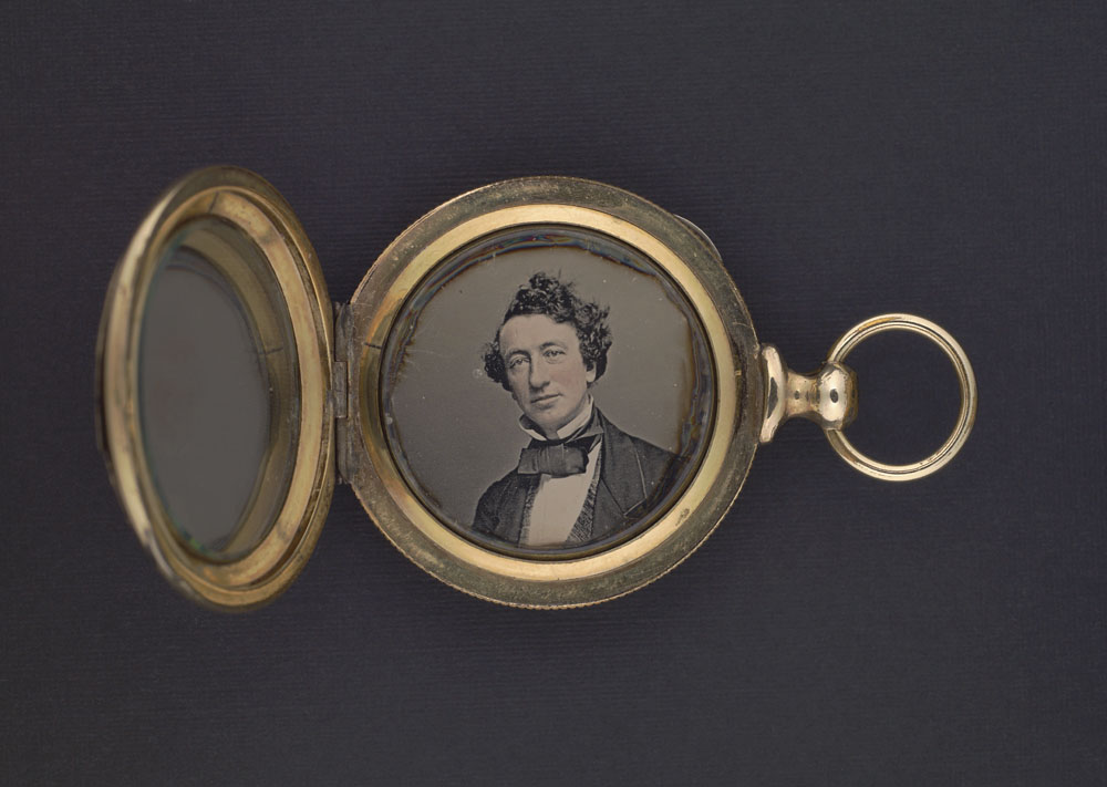 Daguerreotype of John A. MacDonald contained in a gold locket. (item 4)