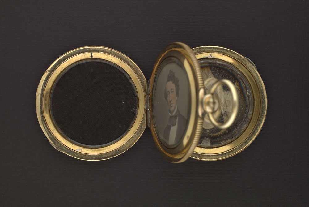 Daguerreotype of John A. MacDonald contained in a gold locket. (item 5)