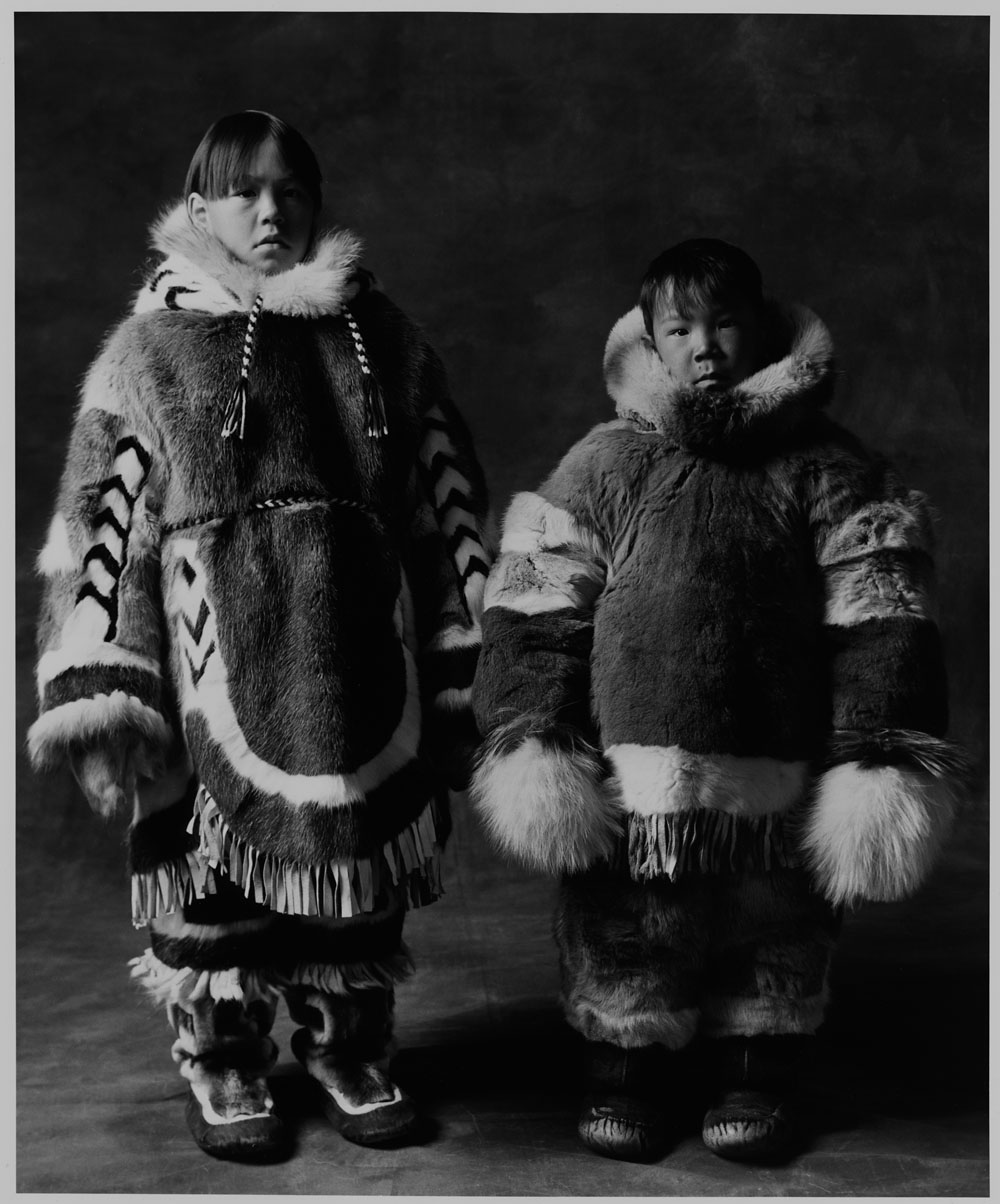 Two boys wearing caribou parkas and sealskin boots, unknown location, Nunavut, 1994