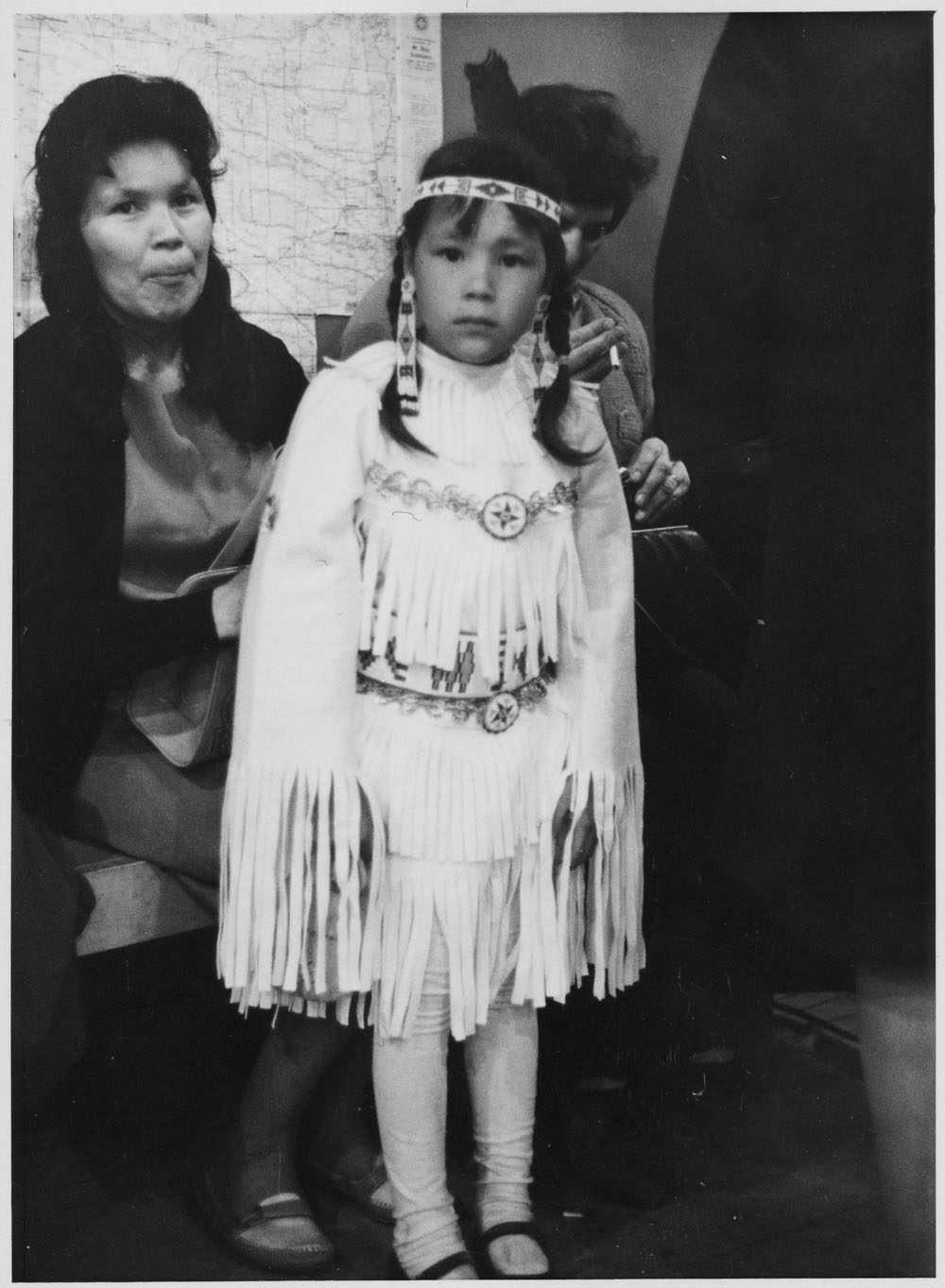 Mother with daughter wearing regalia