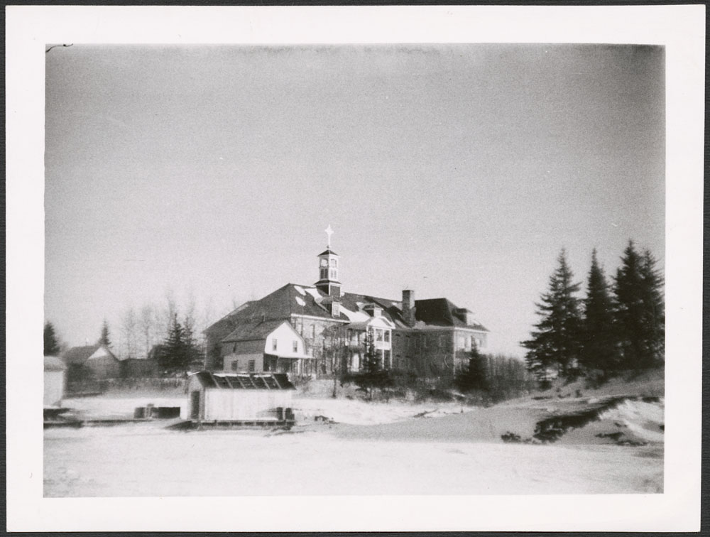 Cross Lake Indian Residential School, view of the school from the frozen lake, December 1939