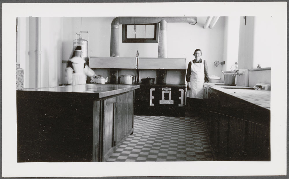 Cross Lake Indian Residential School, a nun and another woman in the kitchen, February 1940