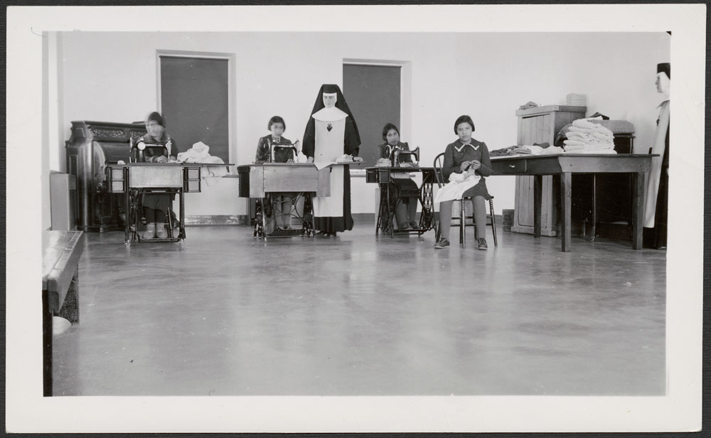 Cross Lake Indian Residential School, female students and nuns in the sewing room, February 1940