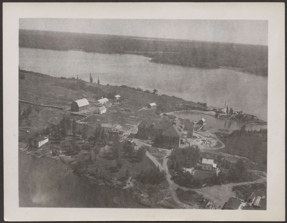Cross Lake Indian Residential School, aerial view of buildings and barns, summer 1940