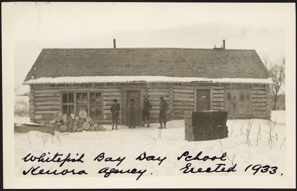 Whitefish Bay Indian Day School, view of the school with four men standing out front, Whitefish Bay, 1941