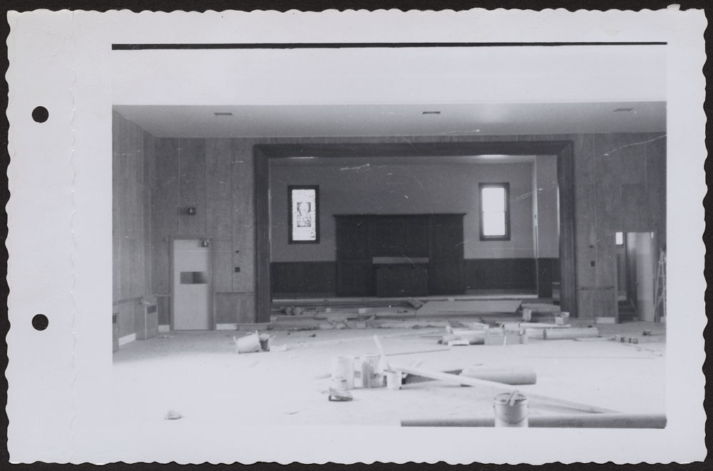 Bishop Horden Hall (Moose Factory Indian Residential School), auditorium and stage at front of dormitory, Moose Factory Island, May 24, 1956