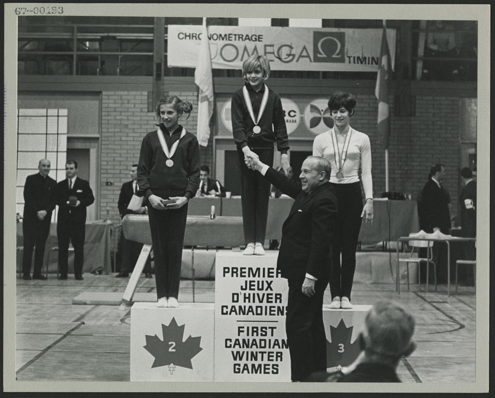 Prime Minister Lester B. Pearson congratulating medal winners of womens gymnastics at the first Canadian Winter Games at Québec City