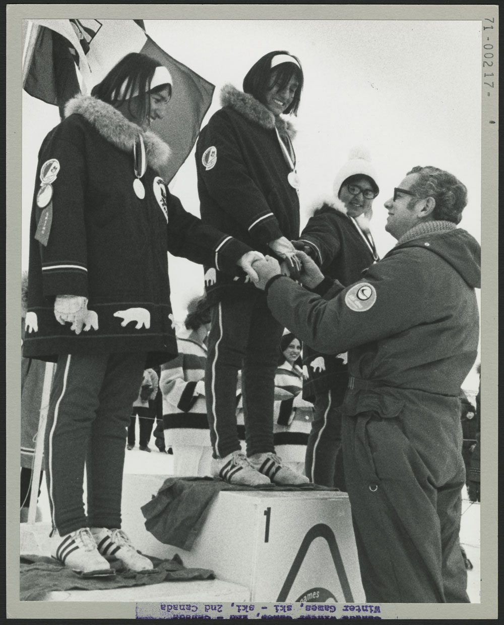 Manpower and Immigration Minister Otto Lang congratulates Shirley Firth (gold), Sharon Firth (silver), and Roseanne Allen (bronze) in the 5 km cross-country during the second Canada Winter Games