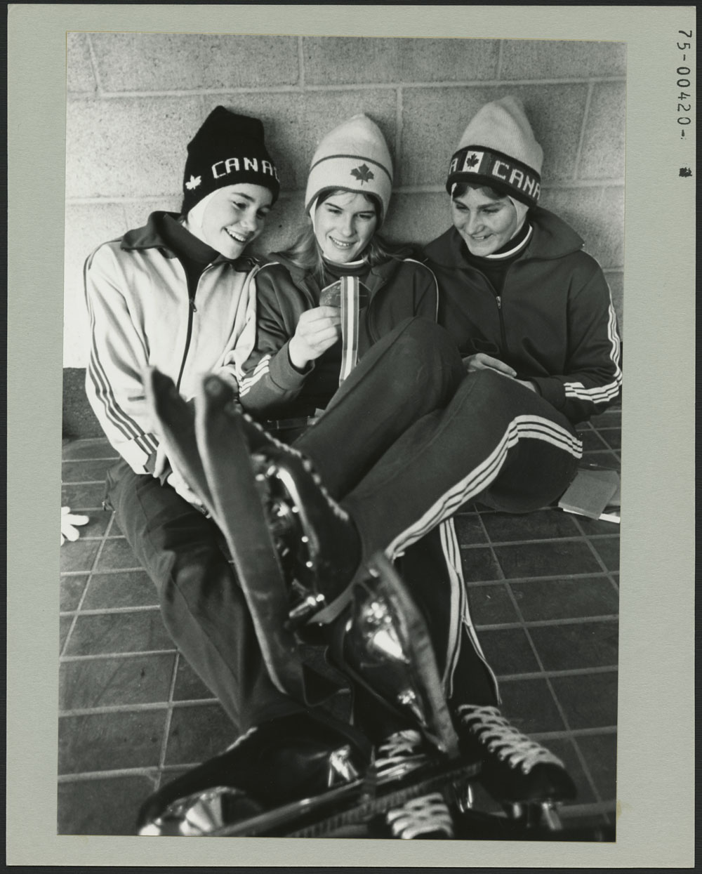 MANITOBA SWEEPS: Three Manitoba speed skaters swept the women's 400-metre event Wednesday to take the first three medals at the Third Canada Winter Games, at Lethbridge, Alberta. Gold medalist Kathy Vogt is flanked by teammates Pat Durnin (left) and Barbara Johnston, who tied for second-place silver