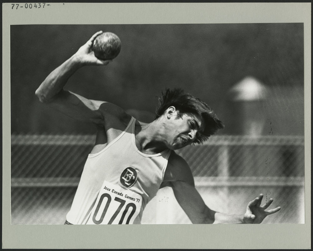 David Steen of British Columbia, at the 3rd Canada Summer Games (St. John's, Newfoundland), hefts the shotput in one of three events of the decathlon in which he placed second with 2038 points after the three events
