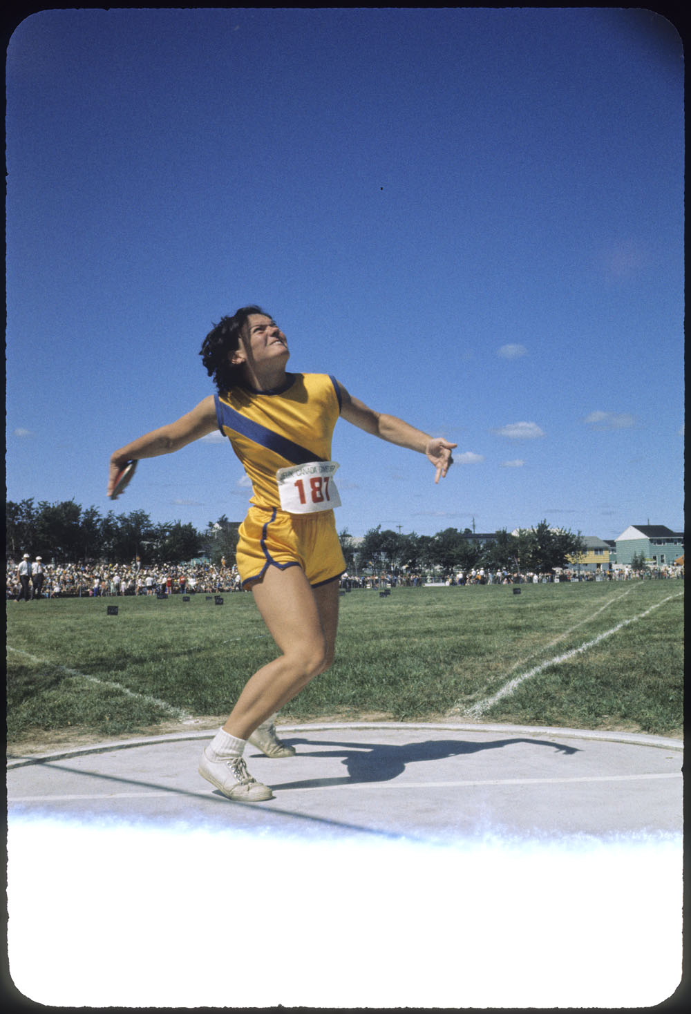 Female discus thrower in middle of discus toss during the first Canadian Summer Games at Halifax-Dartmouth