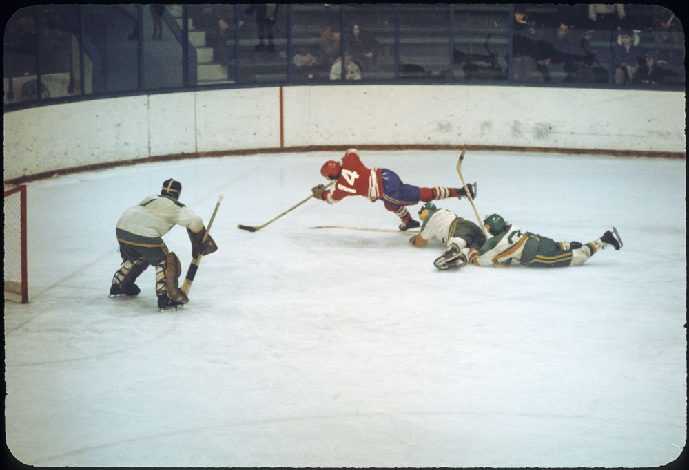 Bob Gainey (number 14) makes a diving play during the gold medal hockey game between Ontario and Alberta during the second Canada Winter Games in Saskatoon
