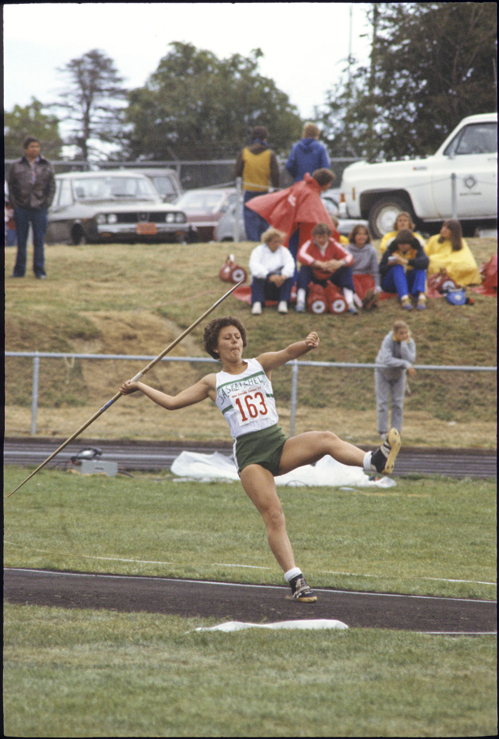 Judy Schitzler of Saskatoon in mid-throw for the track and field javelin during the Third Canada Summer Games, St. John's, Newfoundland